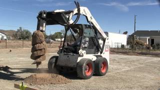 Digging holes With a Bobcat auger attachment