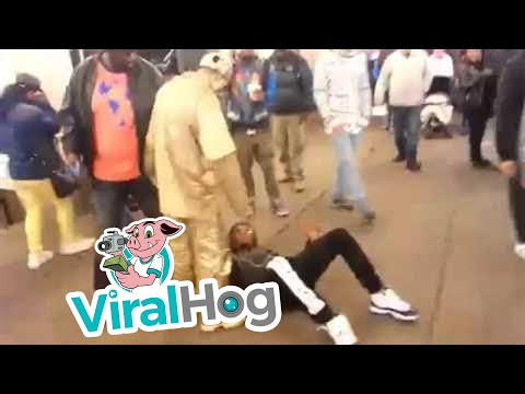Thug Tries to Rob a Street Performer = Gets a Kick to the Face || ViralHog