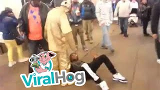 Thug Tries to Rob a Street Performer = Gets a Kick to the Face