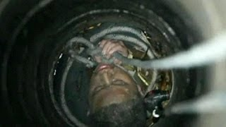 China: Man rescued after falling down 30-metre well - no comment