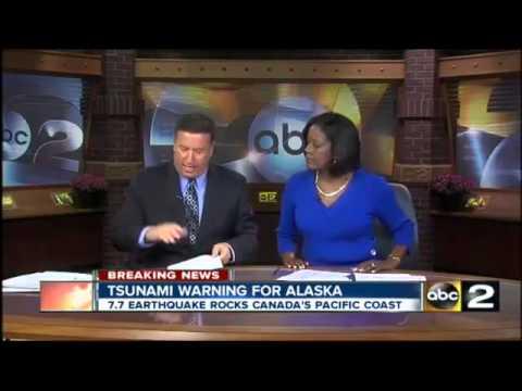 Warning lifted after Canada quake triggered Hawaii tsunami scare.