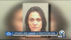 Officer's wife charged in prostitution ring