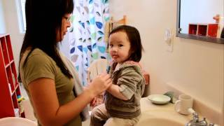 Donna brushes teeth with Mommy at 18 months