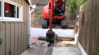 Excavator climbing hillside #3
