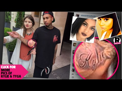 Tyga allegedly tattoos kylie jenner name on his arm and for Tyga arm tattoos