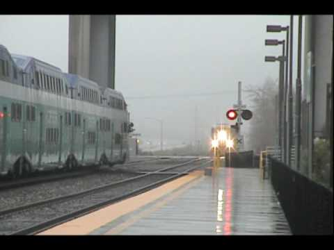 Coaster Train Meets Amtrak Pacific Surfliner 583 in Sorrento Valley on a Rainy day in Spring, 2005