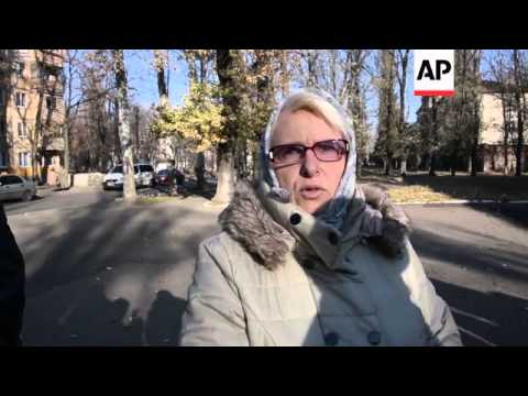 People queue to vote in rebel-held area of Donetsk