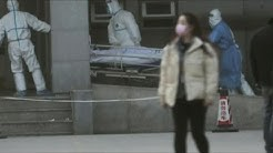 China puts cities at epicenter of new coronavirus outbreak on lockdown