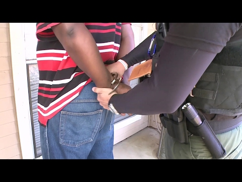 Immigration and Customs Enforcement Officers Arresting Criminal Alien Sex Offenders