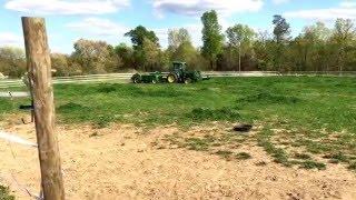 John Deere 4066R pulling old manure spreader