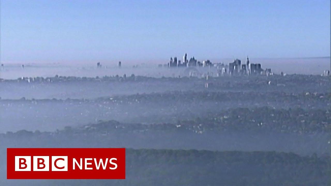 Smoky haze blankets Sydney as bushfires rage - BBC News