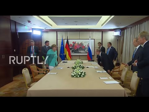 China: Putin and Merkel talk bilateral issues, including Ukraine