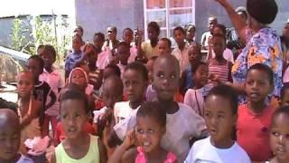 Gogo & Children Sing In Motsoaledi, South Africa