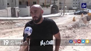 سكان بمنطقة طبربور في عمّان يشكون من عدم تعبيد الشارع وكثرة الحفر فيه - (22-9-2017)