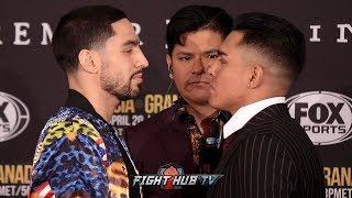 DANNY GARCIA SMILES AT ADRIAN GRANADOS DURING FACE OFF AT FINAL PRESS CONFERENCE