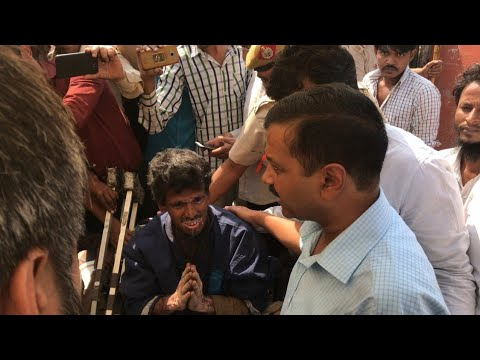 Delhi CM Arvind Kejriwal visiting the Okhla Jhuggi area where fire accident happened, meeting public