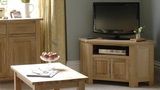 Strong, classic styling is combined with great functionality in this Rivermead Oak Corner TV & DVD Cabinet. Designed to fit