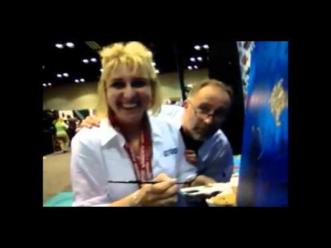 Rogest and Rick Stratton Paint a Fish for Wounded Warriors at DEMA 2011