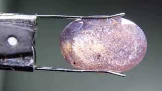 Iridescent inclusions in Bloodshot Iolite gemstone