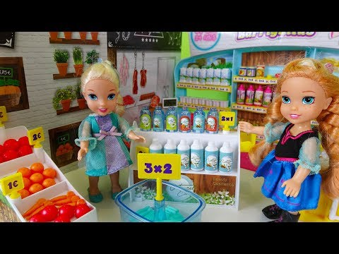 elsa-and-anna-toddlers-go-shopping-at-the-supermarket-and-buy-toys