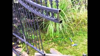 Ornamental iron automatic gate hit by car and mobile welder KenG Fence in Boulder CO.