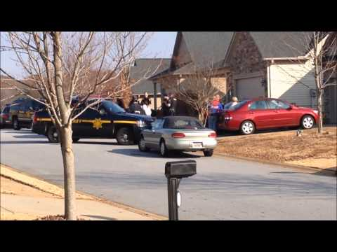 LARGE CONTINGENCY OF GREENVILLE COUNTY SHERIFFS OFFICERS CONDUCTING 3 ARRESTS AT HOME IN GREENVILLE.