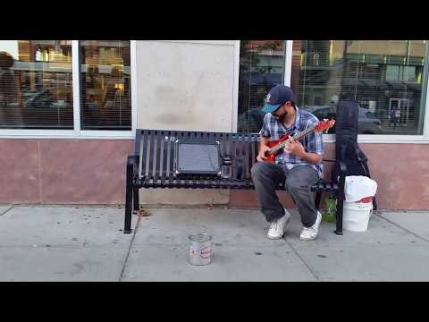 Slap bass player on pearl street in Boulder