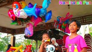 Anak lucu beli mainan anak balita balon karakter LOL Surpris...