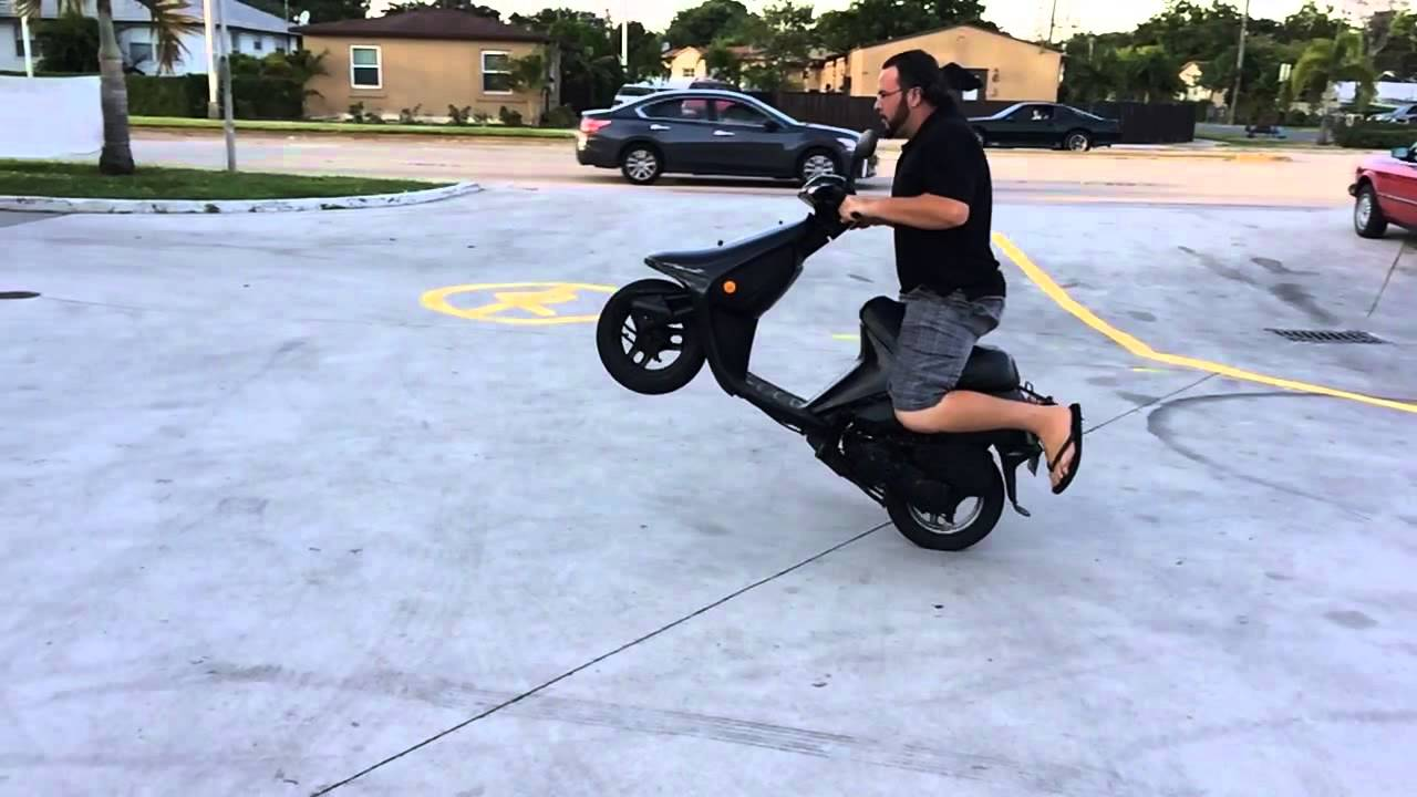 Having Fun On A Honda Elite Scooter Pop Wheelie Boy