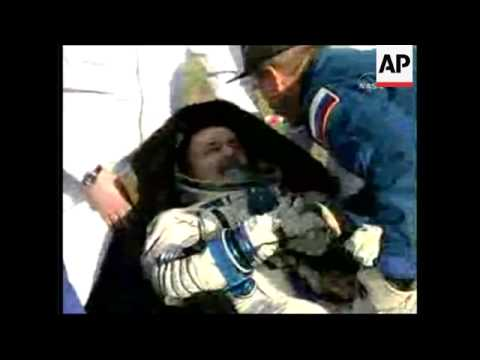 Space tourist emerges from Soyuz capsule after Earth landing