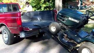 One Man Ez Load Loads A Riding Mower Onto A Pickup Truck