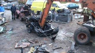 Ford Scorpio crushed by old excavator