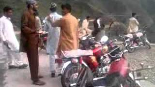 pakistani boy with girl bike villing