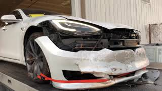 Tesla picking up after the accident....  Totaled or not???