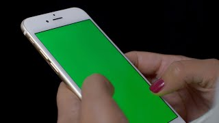 Green Screen Shoot - A female tapping and scrolling her smartphone