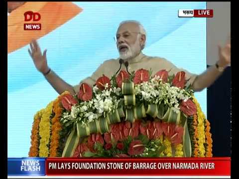 PM addresses people at laying foundation stone of barrages over Narmada river in Gujarat
