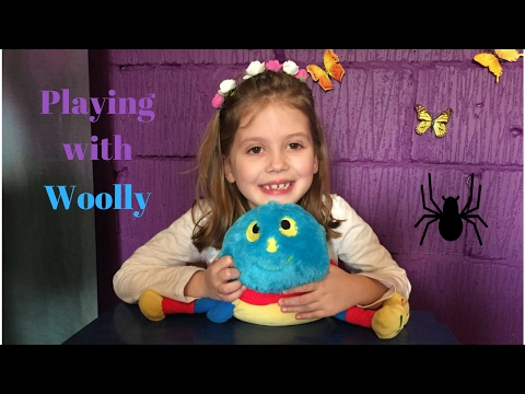 Cute little girl playing with Woolly - toy spider - Woolly and Tig