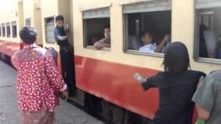 Loading a Train outside of Yangon, Myanmar