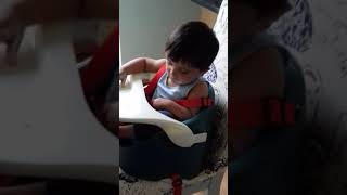 Funny baby sleeping while eating