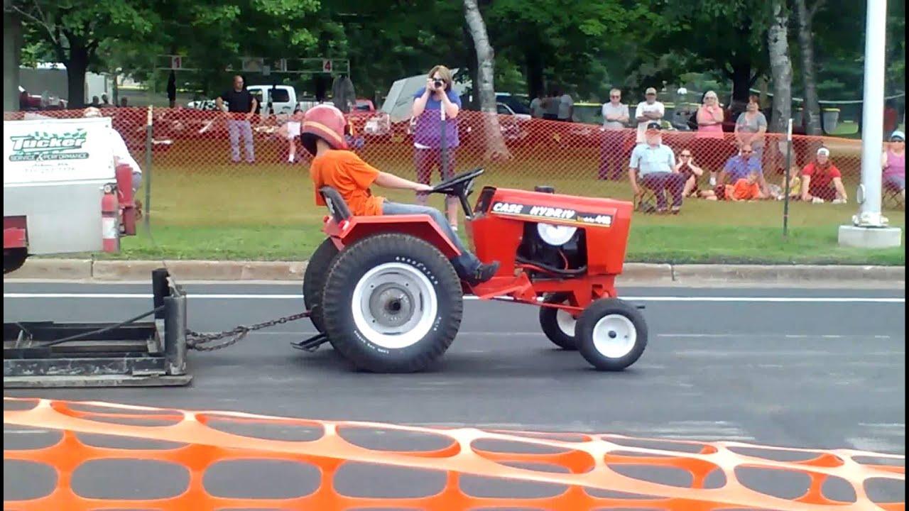 Gavin pulling Case garden tractor YouTube