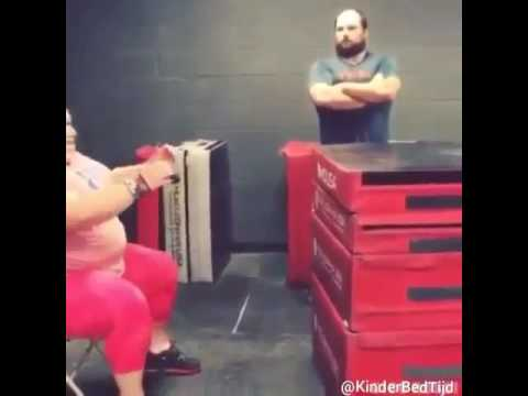 Fat woman jumping on some mats