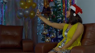 Beautiful young girl enjoying and clicking selfies during Christmas party in India