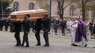 Hollande among guests at funeral for Total CEO