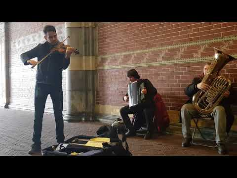 Amsterdam Rijksmuseum street artist plays classic music Vivaldi winter