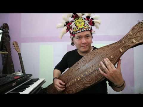 Despacito Luis Fonsi - ft. Daddy Yankee ( Sape' Borneo Traditional instrument version ) Uyau Moris