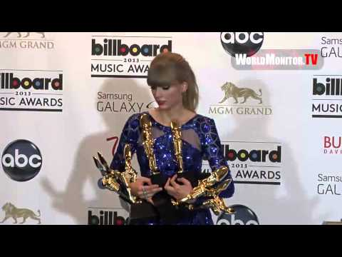 Taylor Swift poses with her Awards backstage at Billboard Music Awards 2013