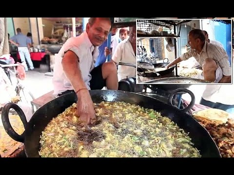 oil man deep hand into boiling oil :-indian super power man