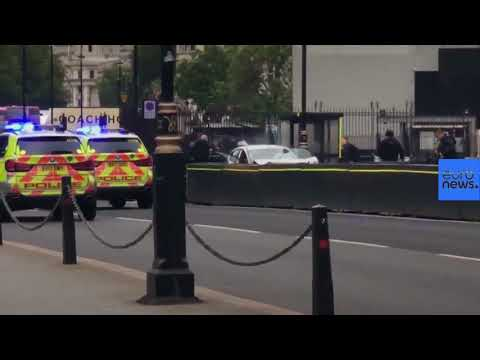Watch - the moments after car crashes into security barriers (exclusive)