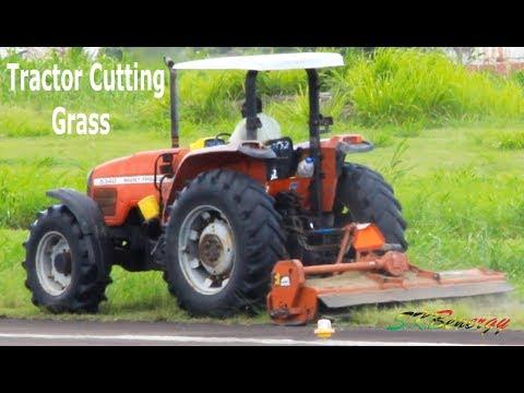 Tractor cutting grass around airport runway @ St. Kitts Airport !!!