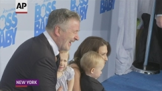 alec baldwin struts boss baby blue carpet with wife and children